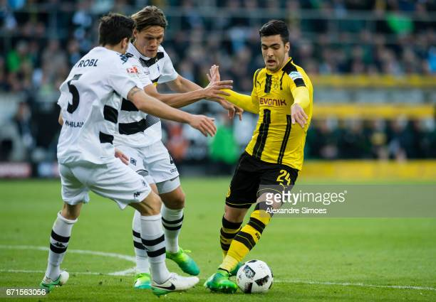 Mikel Merino of Borussia Dortmund challenges Jannik Vestergaard and Tobias Strobl of Borussia Moenchengladbach during the Bundesliga match between...