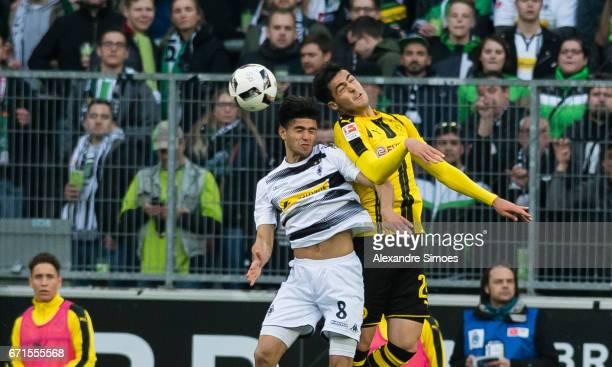 Mikel Merino of Borussia Dortmund challenges Mahmoud Dahoud of Borussia Moenchengladbach during the Bundesliga match between Borussia...