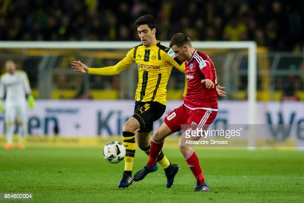 Mikel Merino of Borussia Dortmund challenges Pascal Gross of FC Ingolstadt 04 during the Bundesliga match between Borussia Dortmund and FC Ingolstadt...