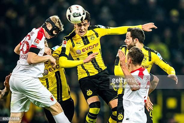 Mikel Merino of Dortmund and Martin Hinteregger of Augsburg in action during the Bundesliga match between Borussia Dortmund and FC Augsburg at Signal...