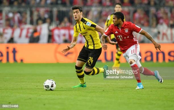 Mikel Merino of Dortmund challenges Douglas Costa of Bayern Muenchen during the Bundesliga match between Bayern Muenchen and Borussia Dortmund at...