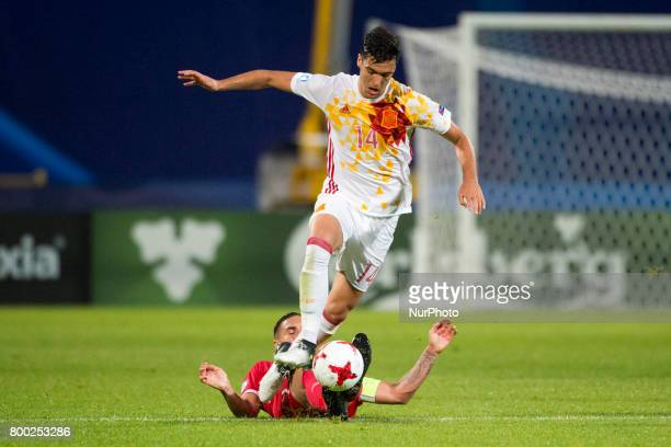 Mikel Merino of Spain tackled by Uros Djurdjevic of Serbia during the UEFA European Under21 Championship 2017 Group B match between Serbia and Spain...