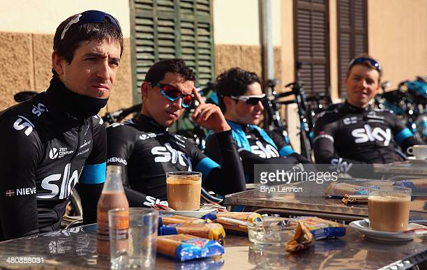 Mikel Nieve of Team SKY enjoys a cafe stop during a training ride on February 3 2014 in Palma de Mallorca Spain
