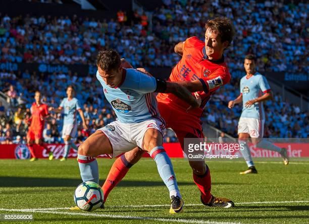 Mikel Oyarzabal of Real Sociedad competes for the ball with Hugo Mallo of Celta de Vigo during the La Liga match between Celta de Vigo and Real...