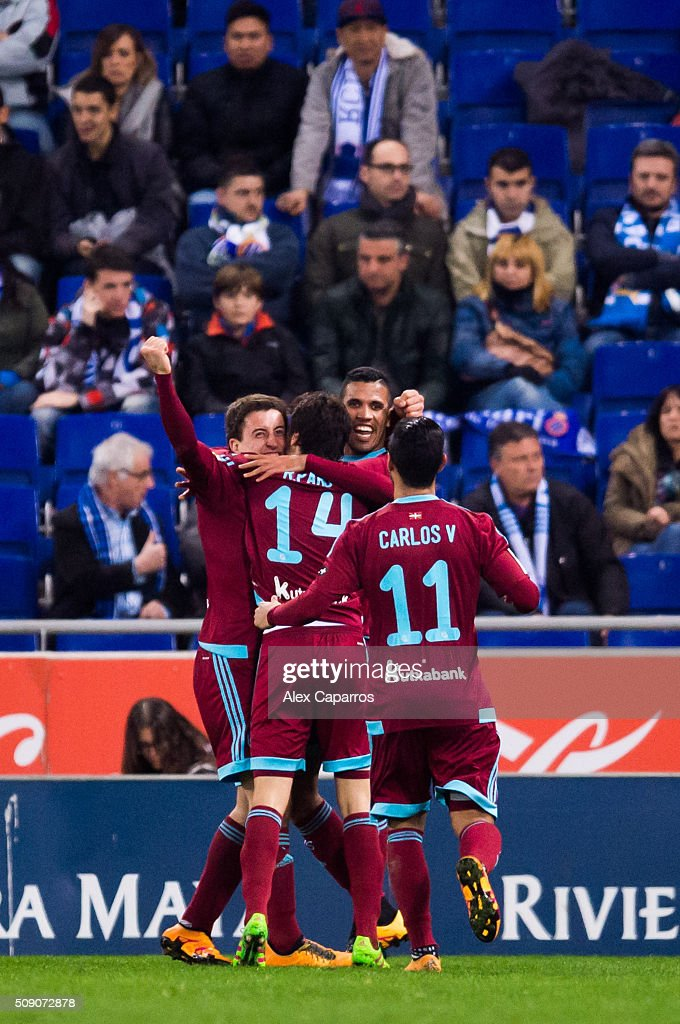 Mikel Oyarzabal (L) of Real Sociedad de Futbol celebrates with his teammates Ruben Pardo (2nd L), Jonathas Cristian de Jesus (2nd R) and <a gi-track='captionPersonalityLinkClicked' href=/galleries/search?phrase=Carlos+Vela&family=editorial&specificpeople=2217707 ng-click='$event.stopPropagation()'>Carlos Vela</a> (R) after scoring his team's third goal during the La Liga match between RCD Espanyol and Real Sociedad de Futbol at Cornella-El Prat Stadium on February 8, 2016 in Barcelona, Spain.