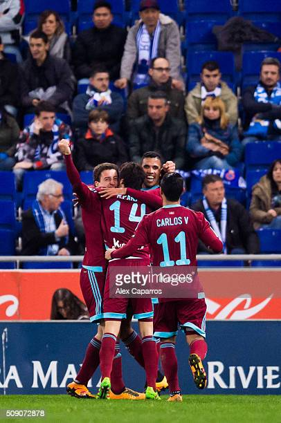 Mikel Oyarzabal of Real Sociedad de Futbol celebrates with his teammates Ruben Pardo Jonathas Cristian de Jesus and Carlos Vela after scoring his...
