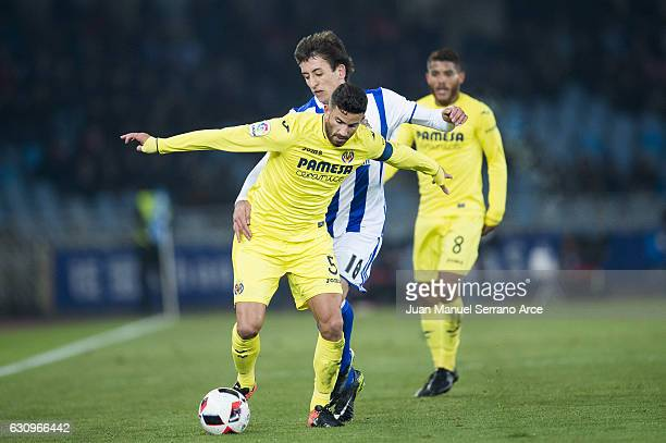 Mikel Oyarzabal of Real Sociedad duels for the ball with Mateo Musacchio of Villarreal CF during the Copa del Rey Round of 16 first leg match between...