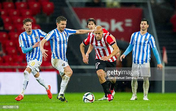 Mikel Rico of Athletic Club duels for the ball with Ignacio Camacho of Malaga CF during the Copa del Rey Quarter Final Second Leg match between...