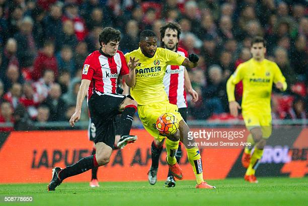 Mikel San Jose of Athletic Club Bilbao competes for the ball with Cedric Bakambu of Villarreal CF during the La Liga match between Athletic Club...