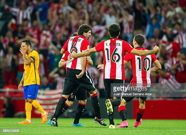 Mikel San Jose of Athletic Club celebrates after scoring goal during the Super Cup first leg match between of Athletic Club and FC Barcelona at San...