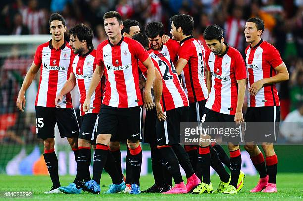Mikel San Jose of Athletic Club celebrates with his team mates after scoring the opening goalduring the Spanish Super Cup first leg match between FC...