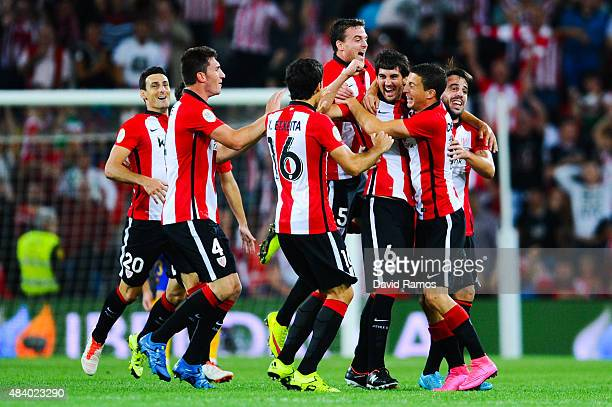 Mikel San Jose of Athletic Club celebrates with his teammates after scoring the opening goalduring the Spanish Super Cup first leg match between FC...