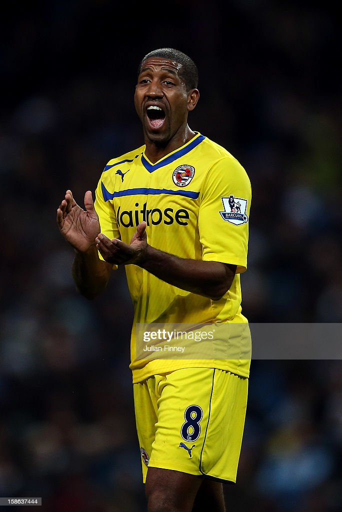 Mikele Leigertwood of Reading encourages his team during the Barclays Premier League match between Manchester City and Reading at Etihad Stadium on December 22, 2012 in Manchester, England.