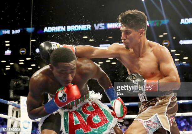 Mikey Garcia punches Adrien Broner during their Junior Welterwight bout on July 29 2017 at the Barclays Center in the Brooklyn borough of New York...