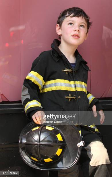 Mikey Robinson of South Boston watched the fire for about 45 minutes with his father Michael Robinson until they were told by an official that...