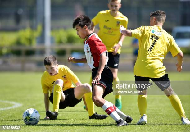 Mikey Saunders of Southampton dribbles past Carl Johnston of County Antrim during the NI Super Cup junior section game between Southampton and County...