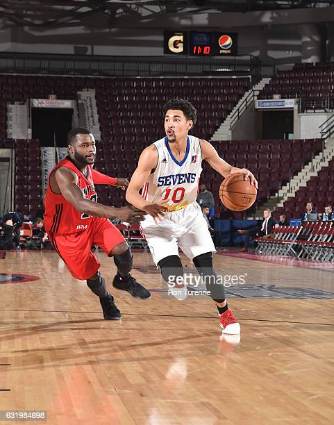Mikh McKinney of the Windy City Bulls handles the ball against Will Bynum of the Delaware 87ers as part of 2017 NBA DLeague Showcase at the Hershey...