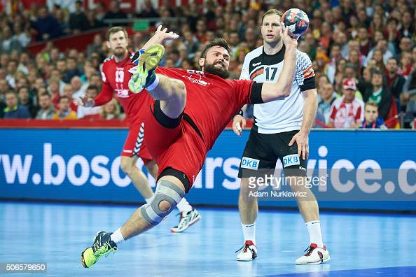Mikhail Chipurin from Russia throws the ball during the Men's EHF Handball European Championship 2016 match between Germany and Russia at Centennial...