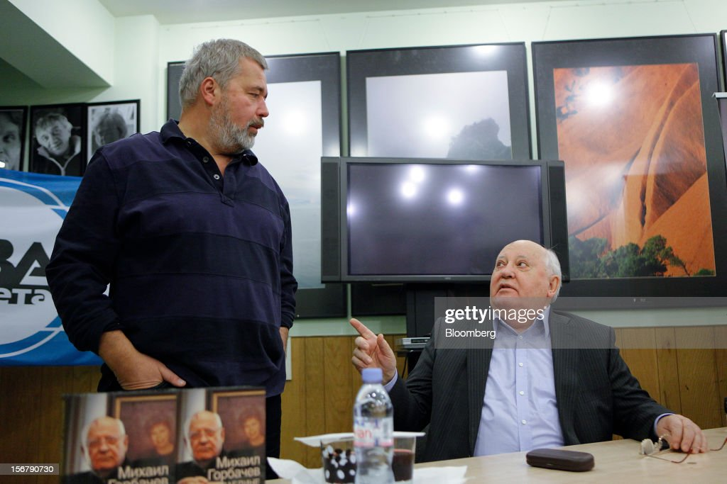 <a gi-track='captionPersonalityLinkClicked' href=/galleries/search?phrase=Mikhail+Gorbachev&family=editorial&specificpeople=93773 ng-click='$event.stopPropagation()'>Mikhail Gorbachev</a>, former Soviet leader, right, gestures while talking to Dmitri Muradov, editor-in-chief of Novaya Gazeta, during a book signing event at the Novaya Gazeta newspaper office in Moscow, Russia, on Wednesday, Nov. 21, 2012. The book, titled 'Alone With Myself,' chronicles Gorbachev's life from his childhood to the 1991 demise of the Soviet Union. Photographer: Alexander Zemlianichenko Jr./Bloomberg via Getty Images
