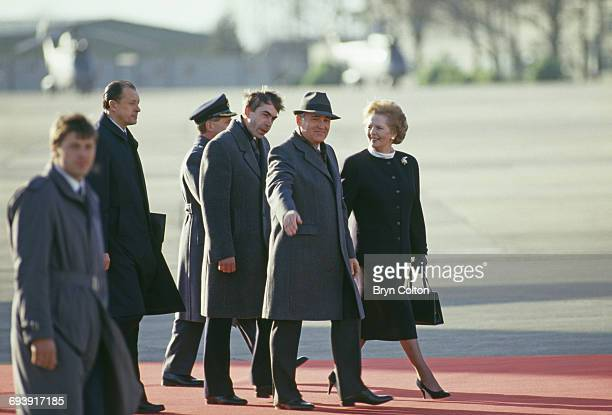 Mikhail Gorbachev Russian Politburo member and second in line at the Kremlin walks along the red carpet with Margaret Thatcher UK Prime Minister...