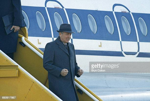 Mikhail Gorbachev Russian Politburo member and second in line at the Kremlin reacts with delight as he steps of the aircraft at London Heathrow...