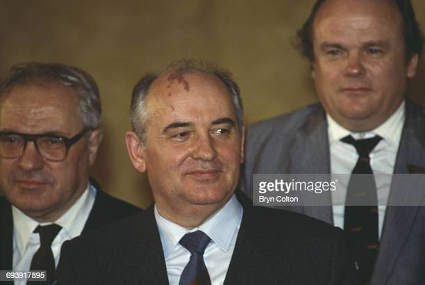 Mikhail Gorbachev Russian Politburo member and second in line at the Kremlin centre listens during a welcome speech in the Palace of Westminster the...