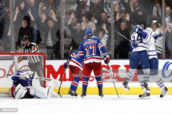 Mikhail Grabovski and Nikolai Kulemin of the Toronto Maple Leafs celebrate the teams overtime goal on Henrik Lundqvist of the New York Rangers as...