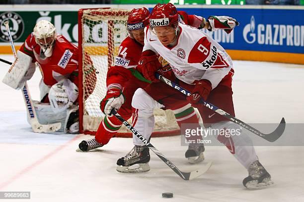 Mikhail Grabovski of Belarus challenges Kasper Degn of Denmark during the IIHF World Championship qualification round match between Belarus and...