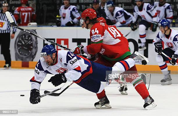 Mikhail Grabovski of Belarus tackles Andrej Podkonicky of Slovakia during the IIHF World Championship group A match between Belarus and Slovakia at...