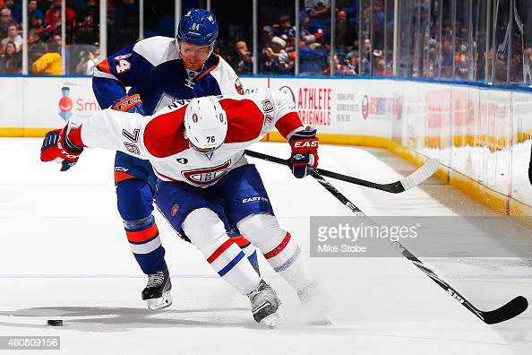 Mikhail Grabovski of the New York Islanders and PK Subban of the Montreal Canadiens battle for the puck at Nassau Veterans Memorial Coliseum on...