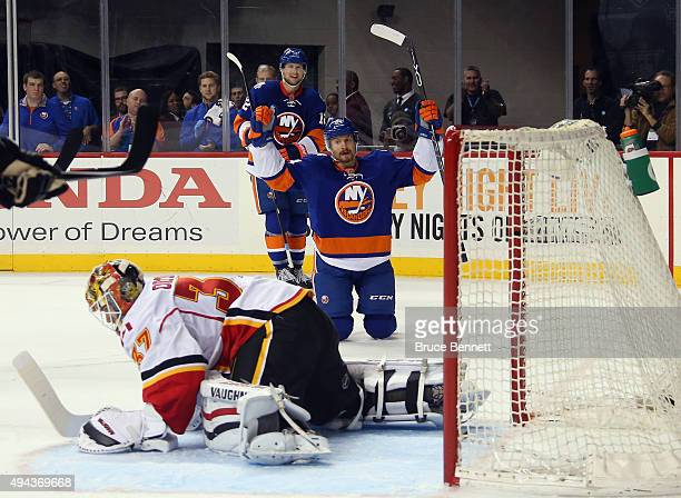 Mikhail Grabovski of the New York Islanders celebrates his powerplay goal at 1401 of the second period against Joni Ortio of the Calgary Flames at...
