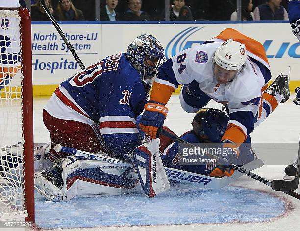 Mikhail Grabovski of the New York Islanders flies past Henrik Lundqvist of the New York Rangers during the third period at Madison Square Garden on...