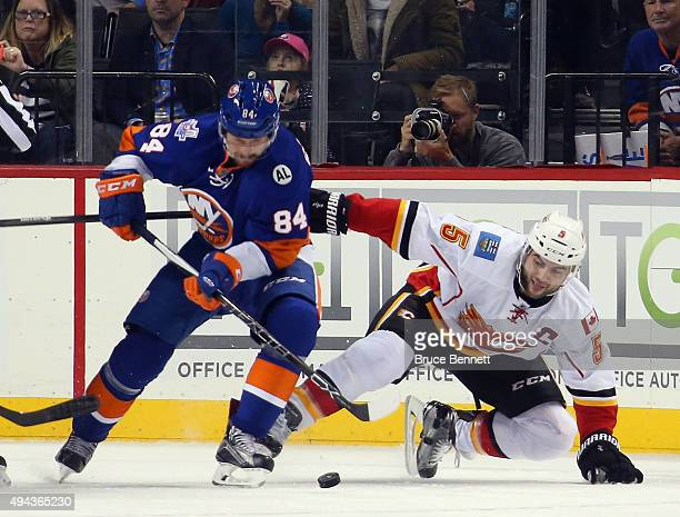 Mikhail Grabovski of the New York Islanders moves the puck around Mark Giordano of the Calgary Flames during the first period at the Barclays Center...