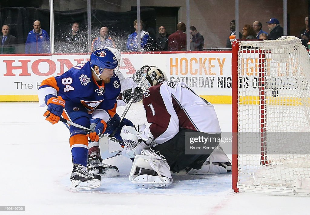<a gi-track='captionPersonalityLinkClicked' href=/galleries/search?phrase=Mikhail+Grabovski&family=editorial&specificpeople=2560547 ng-click='$event.stopPropagation()'>Mikhail Grabovski</a> #84 of the New York Islanders scores a second period goal against <a gi-track='captionPersonalityLinkClicked' href=/galleries/search?phrase=Semyon+Varlamov&family=editorial&specificpeople=6264893 ng-click='$event.stopPropagation()'>Semyon Varlamov</a> #1 of the Colorado Avalanche at the Barclays Center on November 30, 2015 in the Brooklyn borough of New York City.