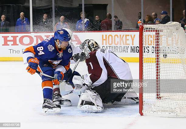 Mikhail Grabovski of the New York Islanders scores a second period goal against Semyon Varlamov of the Colorado Avalanche at the Barclays Center on...
