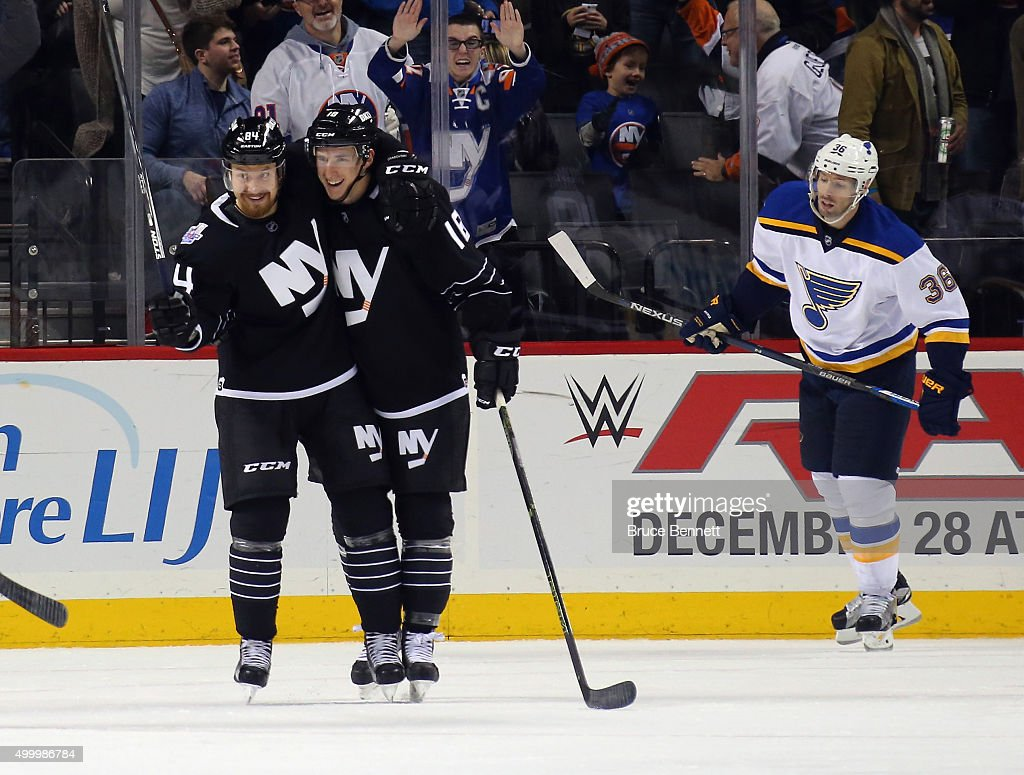 Mikhail Grabovski #84 of the New York Islanders (l) scores a third period goal against the St. Louis Blues and is joined by Ryan Strome #18 (r) at the Barclays Center on December 4, 2015 in Brooklyn borough of New York City.