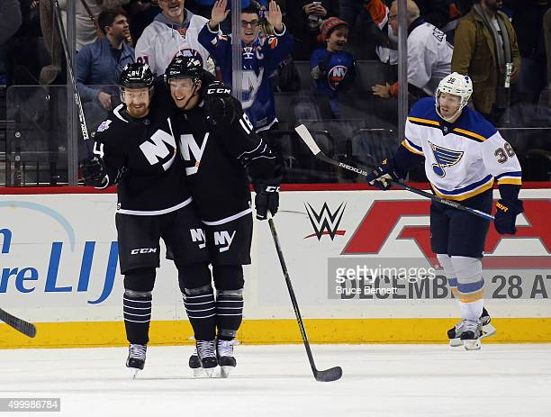 Mikhail Grabovski of the New York Islanders scores a third period goal against the St Louis Blues and is joined by Ryan Strome at the Barclays Center...