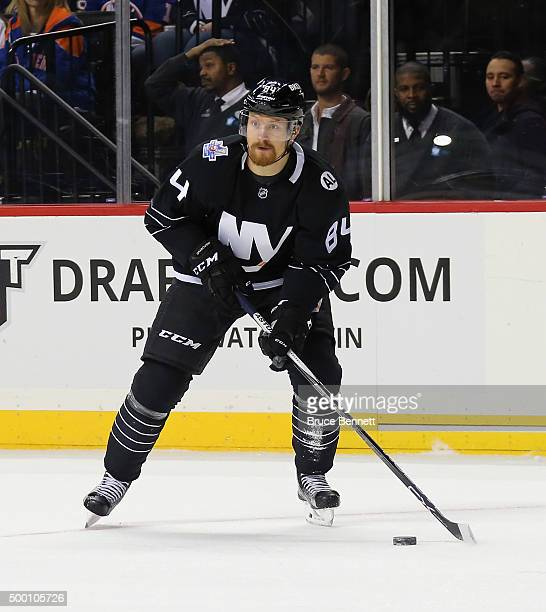 Mikhail Grabovski of the New York Islanders skates against the St Louis Blues at the Barclays Center on December 4 2015 in Brooklyn borough of New...