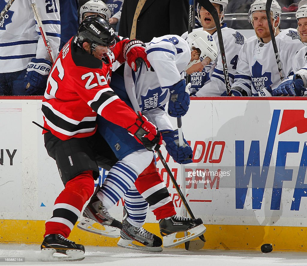 Mikhail Grabovski #84 of the Toronto Maple Leafs and Patrik Elias #26 of the New Jersey Devils battle for a loose puck during the game at the Prudential Center on April 6, 2013 in Newark, New Jersey.