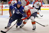 Mikhail Grabovski of the Toronto Maple Leafs battles with Stephen Weiss of the Florida Panthers during game action March 23 2010 at the Air Canada...