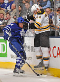 Mikhail Grabovski of the Toronto Maple Leafs checks Dennis Seidenberg of the Boston Bruins during game action April 3 2010 at the Air Canada Centre...