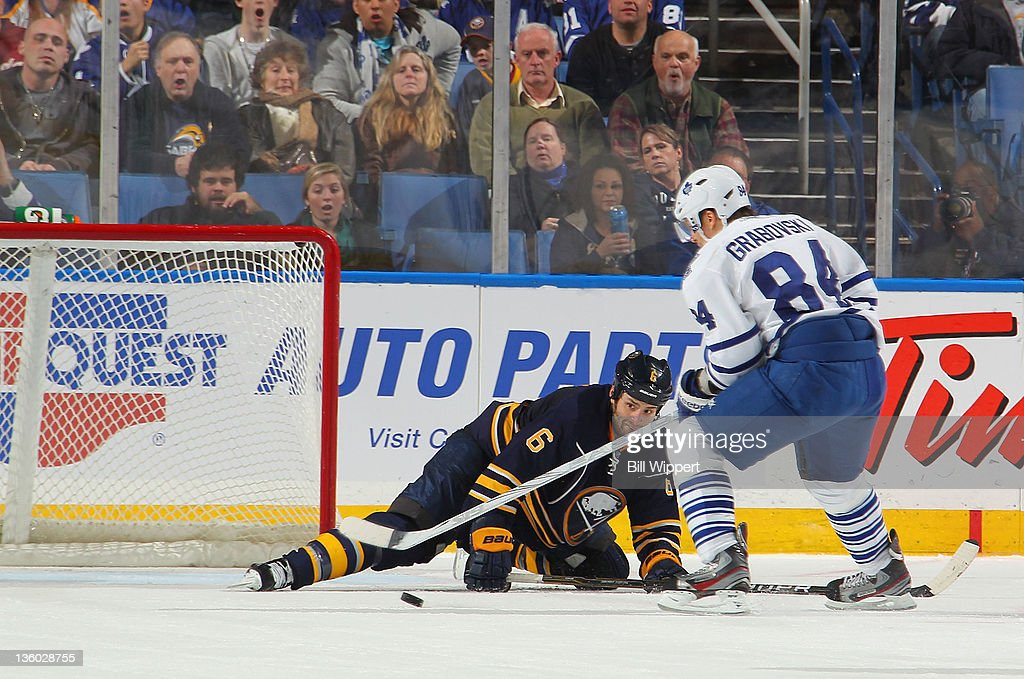 <a gi-track='captionPersonalityLinkClicked' href=/galleries/search?phrase=Mikhail+Grabovski&family=editorial&specificpeople=2560547 ng-click='$event.stopPropagation()'>Mikhail Grabovski</a> #84 of the Toronto Maple Leafs fires the puck past Mike Weber #6 of the Buffalo Sabres for a third period goal at First Niagara Center on December 16, 2011 in Buffalo, New York.