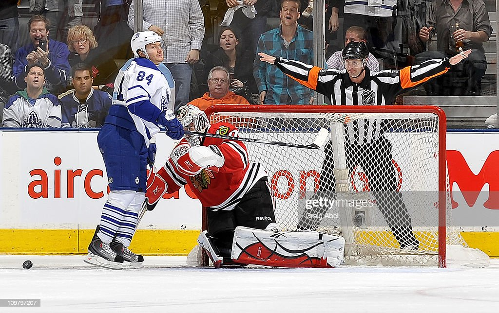 Mikhail Grabovski #84 of the Toronto Maple Leafs is stopped by Corey Crawford #50 of the Chicago Blackhawks during a penalty shot attempt March 5, 2011 at the Air Canada Centre in Toronto, Ontario, Canada.