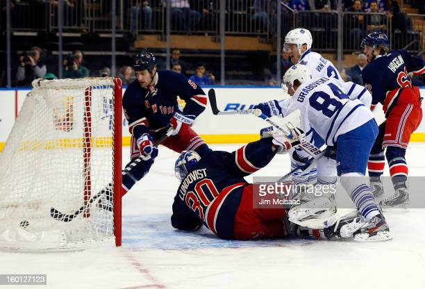 Mikhail Grabovski of the Toronto Maple Leafs scores a first period goal past Henrik Lundqvist and Dan Girardi of the New York Rangers at Madison...