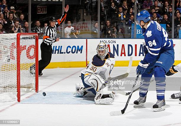 Mikhail Grabovski of the Toronto Maple Leafs scores a secondperiod goal against Ryan Miller of the Buffalo Sabres March 29 2011 at the Air Canada...