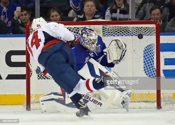 Mikhail Grabovski of the Washington Capitals scores on Henrik Lundqvist of the New York Rangers on a penalty shot during the second period at Madison...