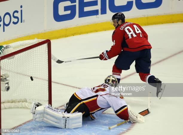Mikhail Grabovski of the Washington Capitals scores the game winning goal in the shootout against Karri Ramo of the Calgary Flames at the Verizon...