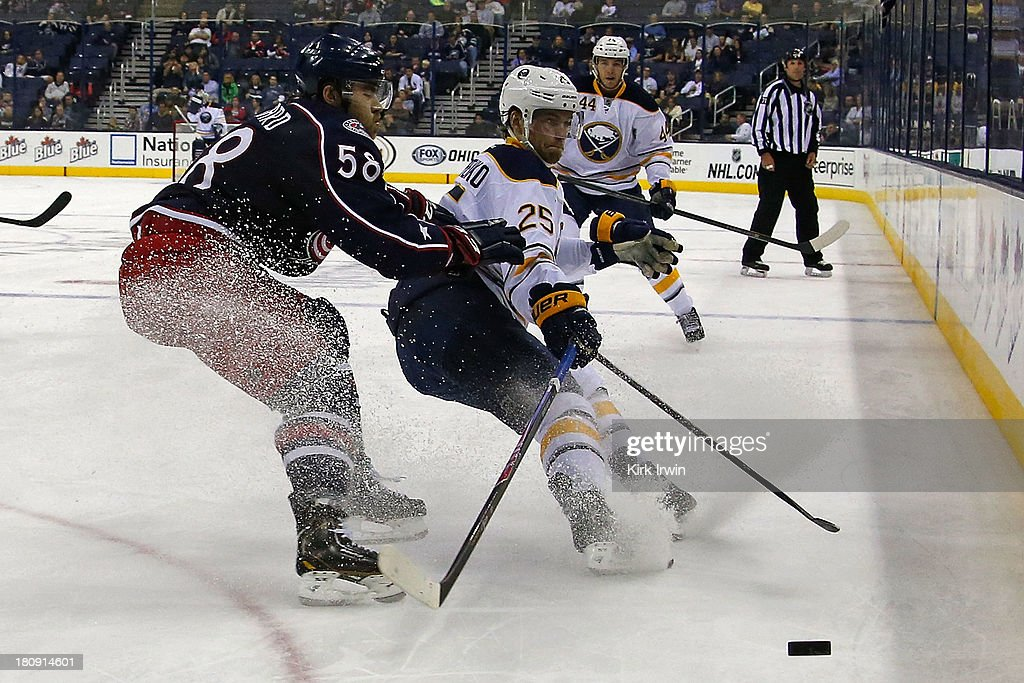 Mikhail Grigorenko #25 of the Buffalo Sabres flips the puck away from David Savard #58 of the Columbus Blue Jackets during the third period on September, 2013 at Nationwide Arena in Columbus, Ohio. Buffalo defeated Columbus 3-1.