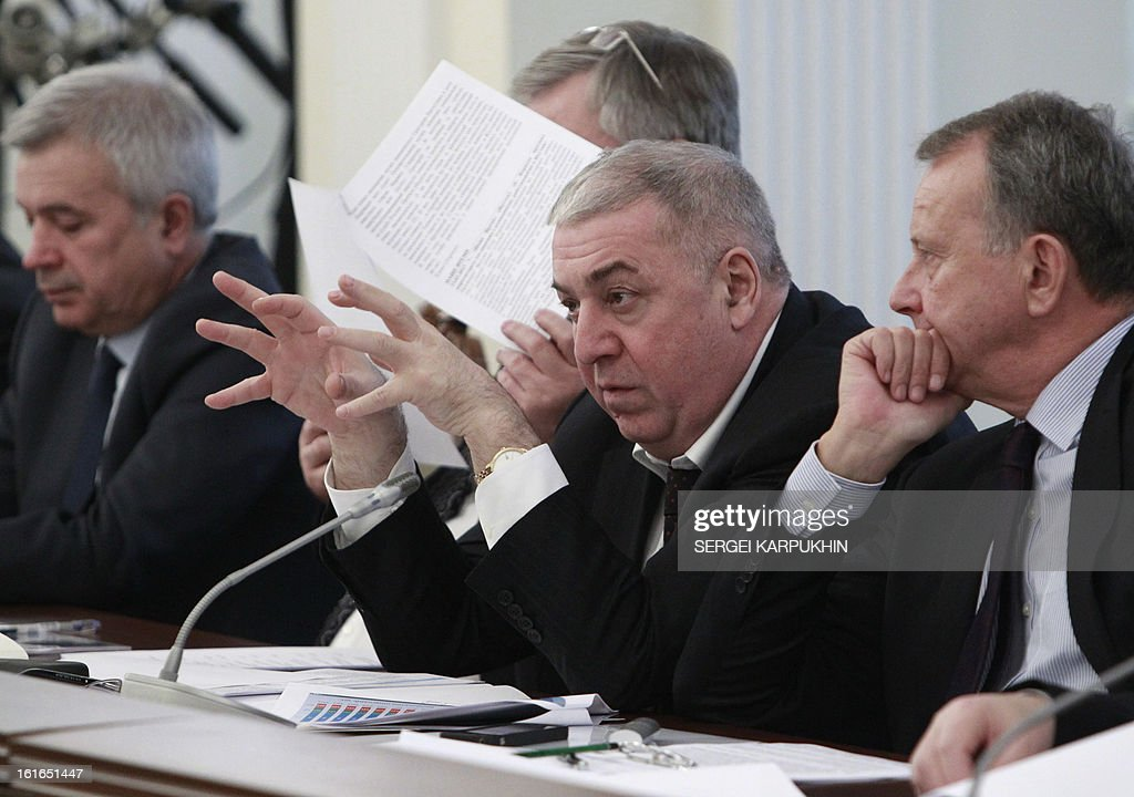 Mikhail Gutseriev (2nd R), President of Oil and Gas Company RussNeft, gestures before a meeting on issues of fuel and energy at the Novo-Ogaryovo state residence outside Moscow, February 13, 2013.