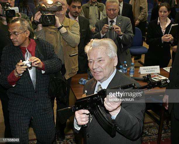 Mikhail Kalashnikov developer of the popular Russian AK47 assault rifle holds an AK103 while he poses for a picture after a press conference in...